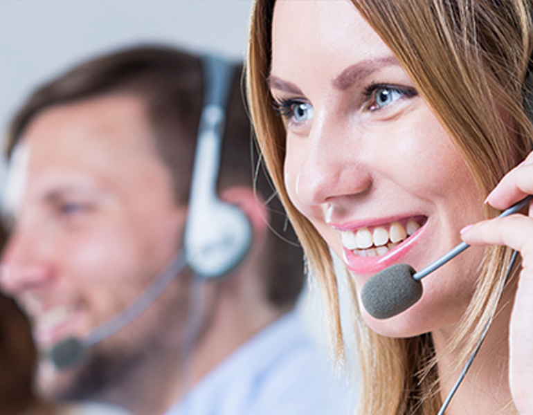 young woman in customer service call center talking to a customer